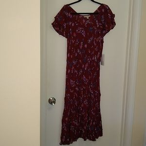 Woman within red floral gauzy vneck dress